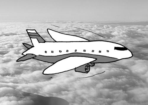 A passenger jet flies above the clouds.